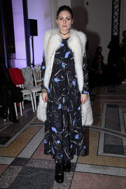 Olivia Palermo kept warm in luxe style with a fur vest by Elie Saab.
