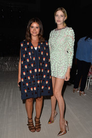 Miroslava Duma hid her petite frame under a printed trapeze dress during the Giambattista Valli Couture fashion show.