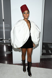 Janelle Monae turned heads in a black-and-white mini dress with oversized bubble sleeves at the Giambattista Valli Fall 2019 show.