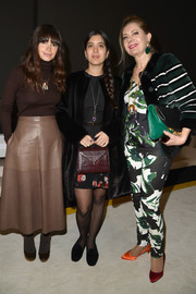 Miroslava Duma sealed off her cold-weather look with brown platform pumps, which she wore with dark tights.