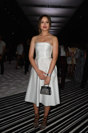 Kristina Bazan went for ladylike elegance in this white strapless dress during the Giambattista Valli Couture show.