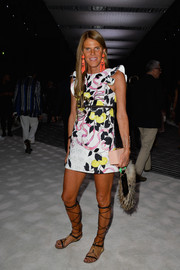 Anna dello Russo opted for a pair of gladiator sandals to complete her outfit.