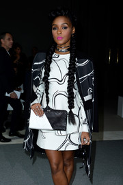 Singer Janelle Monae wore her hair in long pigtail braids while attending shows during Paris Fashion Week,