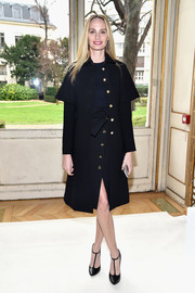 Lauren Santo Domingo looked impeccable in a black coat with gold buttons at the Giambattista Valli fashion show.