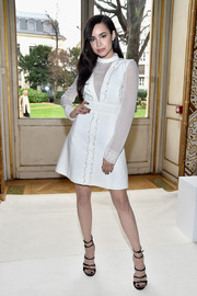 Sofia Carson looked dainty in a little white dress with ruffle detailing at the Giambattista Valli fashion show.