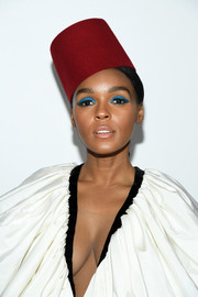 Janelle Monae looked exotic wearing this red fez at the Giambattista Valli Fall 2019 show.