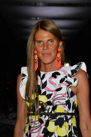 Anna dello Russo highlighted her look with a pair of super-chunky orange earrings.