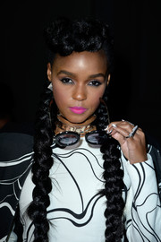 Janelle Monae added a pop of color with neon pink lipstick.