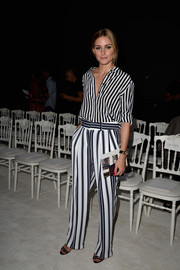 Olivia Palermo looked effortlessly stylish in a black-and-white striped button-down by Tommy Hilfiger at the Giambattista Valli Couture show.