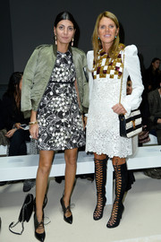Anna dello Russo capped off her eclectic look with a black-and-white striped shoulder bag.