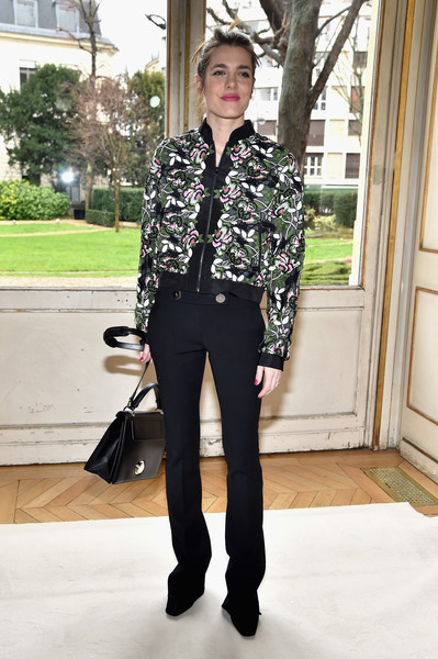 Charlotte Casiraghi hovered between tough and sweet in this Giambattista Valli floral bomber jacket during the label's fashion show.