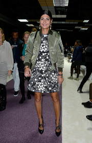 Giovanna Battaglia toughened up her frock with a bulky green bomber jacket.