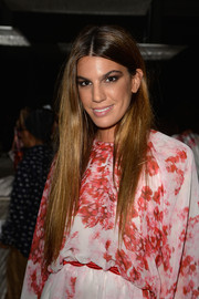 Bianca Brandolini D'Adda wore her ultra-long hair down with a center part during the Giambattista Valli Couture fashion show.