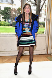 Anna dello Russo added a sporty touch with a bulky blue and black jacket.