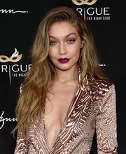 For a bold pop of color to her beauty look, Gigi Hadid swiped on some fuchsia lipstick.