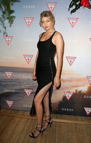 Gigi Hadid put her enviable figure on show in a tight-fitting Guess LBD with a zip-up slit during the label's Spring collection launch in Sydney.