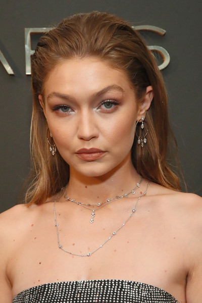 Gigi Hadid Long Straight Cut [messika party,nyc fashion week spring,gigi hadid new collection,milk studios,eyebrow,beauty,fashion model,hairstyle,jewellery,chin,forehead,blond,shoulder,model,new york city,the messika,gigi hadid]