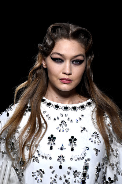 Gigi Hadid Retro Hairstyle [hair,fashion model,face,fashion,eyebrow,lip,hairstyle,beauty,long hair,skin,gigi hadid,miu miu,part,runway,paris,france,paris fashion week womenswear fall,long hair,haute couture,hair m,supermodel,fashion,model,runway,black hair,brown hair,hair]