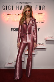 Gigi Hadid went for some '70s zing in a metallic pink bell-bottom pantsuit by Kreist at the Vogue Eyewear #ShowYourParty event.