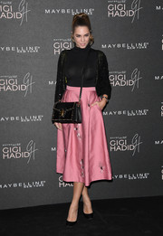 Amber Le Bon was fall-chic in a body-con black turtleneck at the Gigi Hadid x Maybelline party.