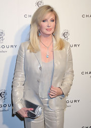 Morgan Fairchild was in a shimmery mood during the Chagoury Couture debut, pairing a metallic silver clutch with her iridescent pantsuit.