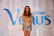 JLo was sophisticated and stylish in a nude blouse with a sequined mini.
