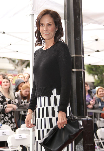 Annabeth Gish paired a black crewneck sweater with a monochrome skirt for Gillian Anderson's Hollywood Walk of Fame ceremony.