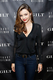 Miranda Kerr went for casual sophistication with a long-sleeve black blouse and a pair of skinny jeans during the 5050 boot anniversary.