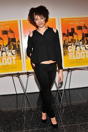 Britne Oldford opted for a cool monochromatic look with these black jeans and a black blouse.