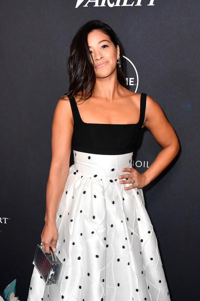 Gina Rodriguez Metallic Purse [clothing,dress,fashion model,cocktail dress,lady,a-line,shoulder,fashion,performance,photo shoot,arrivals,gina rodriguez,power of women,variety,los angeles,beverly hills,california,beverly wilshire four seasons hotel]