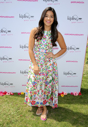 Gina Rodriguez sported a vibrant burst of colors with this floral dress at the #KiplingMakeHappy event.