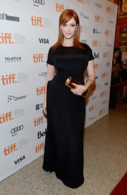 Christina Hendricks showed off her stellar curves in this tight satin black gown at the premiere of 'Ginger & Rosa.'