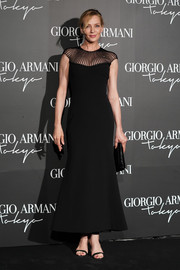Uma Thurman kept it classic and elegant in a black sheer-panel dress at the Giorgio Armani Cruise 2020 show.