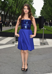 Odeya Rush attended the Giorgio Armani 40th anniversary reception wearing an electric-blue strapless dress with a shiny, speckled bodice.