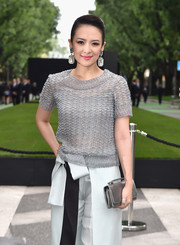 Zhang Ziyi styled her outfit with a metallic silver purse when she attended the Giorgio Armani 40th anniversary reception.