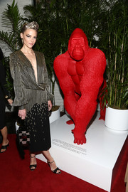 Jaime King paired her dress with black ankle-strap peep-toes by Malone Souliers.