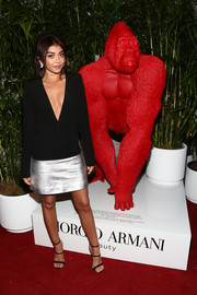 Sarah Hyland polished off her look with a pair of black triple-strap sandals by Sophia Webster.