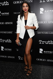 Hannah Bronfman completed her sexy-chic ensemble with black crisscross-strap sandals.