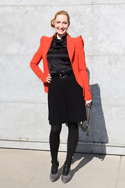 Elna-Margret zu Bentheim added a burst of color to her all-black ensemble with a tangerine bold-shoulder blazer.