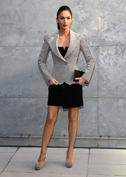Megan Fox attended Milan Fashion Week in a bold shouldered gray tweed blazer.