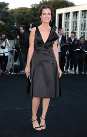 Roberta Armani chose a black satin V-neck frock for her look at the 'One Night Only' event in Rome.