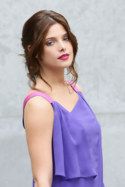 Ashley Greene showed off soft pinned up ringlets at fashion week. Hot pink lipstick completed her look.