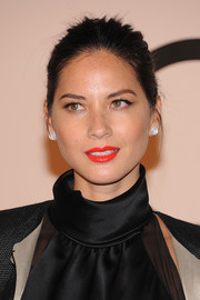 Olivia Munn sported a vibrant orange lip color at the Giorgio Armani SuperPier show.
