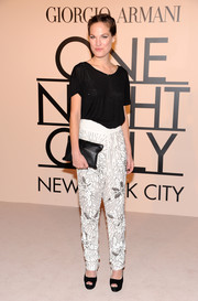 Charlotte Kidd paired beaded white pants with a simple black tee for the Giorgio Armani SuperPier show.