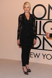 Ellen Barkin attended the Giorgio Armani SuperPier show looking classy in a beaded black Armani blouse.