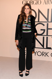 Stella Schnabel teamed black slacks with a colorful button-down and a brocade coat for the Giorgio Armani SuperPier show.