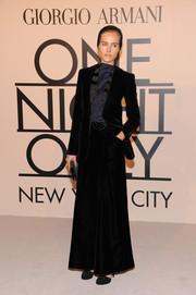 Isabel Lucas looked subdued yet elegant in a black velvet skirt suit during the Giorgio Armani SuperPier show.