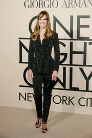A pair of black T-strap sandals added a dose of sexiness to Hilary Swank's outfit at the Giorgio Armani SuperPier show.