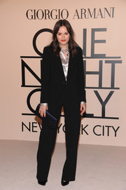Atlanta de Cadenet opted for a simple black pantsuit when she attended the Giorgio Armani SuperPier show.