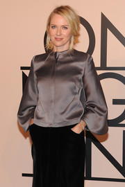 Naomi Watts chose a simple yet elegant gray silk blouse by Armani for the designer's SuperPier show.